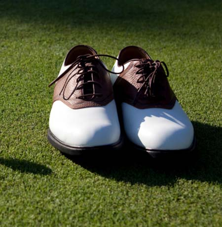 Golf shoes sitting on the green